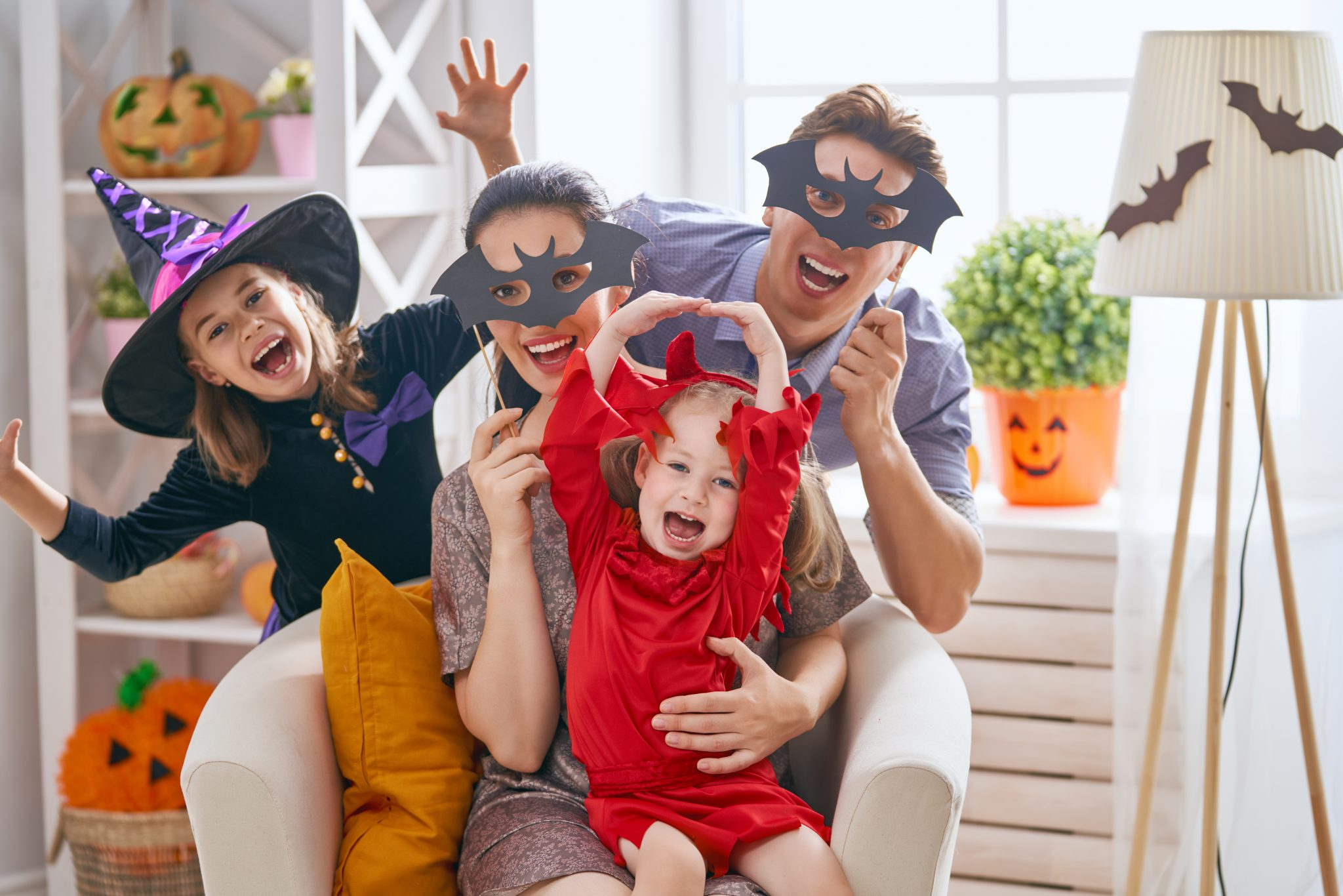Aqua Springs dental in san marcos texas Avoid Candy Overload this Halloween It's that time of year again! Time to take the kids to a fall festival or even go door to door trick or treating around the neighborhood. Every year it's the one night that children get to dress as their favorite superhero, princess, or other character and have a ton of fun doing it. In other words, Halloween is a fun night for all. However, as a parent concerned about your child's dental health, you know that all of that fun (and the pile of candy that goes along with it) can be detrimental to your child's oral health. family celebrating Halloween